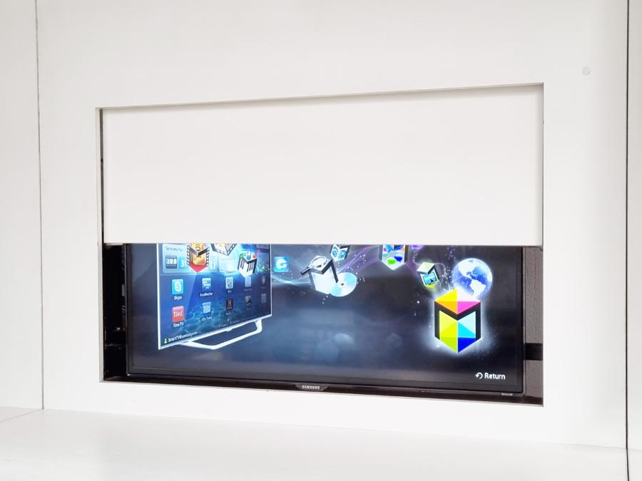 TV mechanist hiding TV behind a panel
